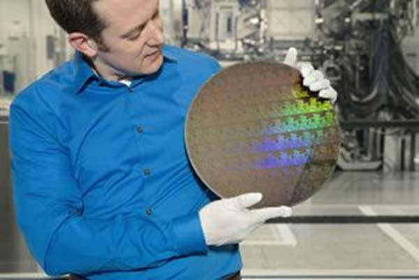 IBM Research scientist Nicolas Loubet holds a wafer of chips with 5nm silicon nanosheet transistors manufactured using an industry-first process that can deliver 40 percent performance enhancement at fixed power, or 75 percent power savings at matched performance. Press release link (Photo Credit: Connie Zhou)