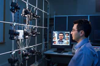 A NIST computer scientist with a system for studying facial recognition software performance. By the National Institute of Standards and Technology - Facial Recognition,