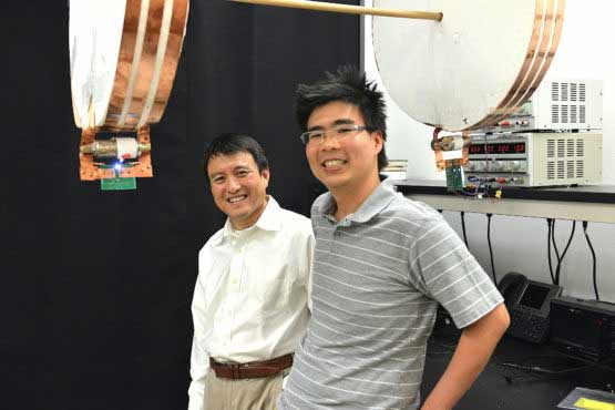Professor Shanhui Fan (left) and graduate student Sid Assawaworrarit have developed a device that can wirelessly charge a moving object at close range. The technology could be used to charge electric cars on the highway, or medical implants and cellphones as you walk nearby. (Image credit: Mark Shwartz/Stanford University)