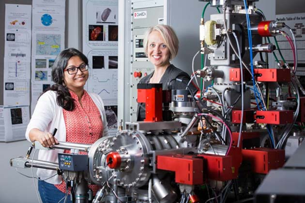 School of Earth and Space Exploration Assistant Professor Christy Till (right) and research assistant professor Maitrayee Bose stand with the NanoSIMS instrument. This advanced mass sprectrometer was a key ingredient in the volcanic crystal discovery because it lets scientists examine the elemental and isotopic composition of microscopic samples smaller than a human hair's thickness.
