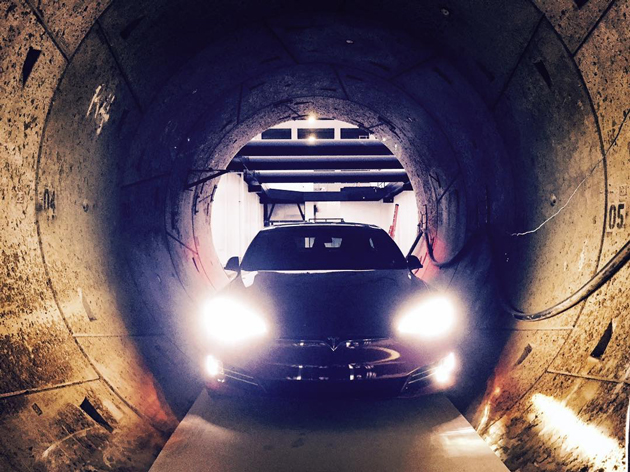 The Tesla Model S at the entrance of The Boring Company's Hawthorne 'test tunnel,' as shared on social media by Elon Musk himself. (Source: Elon Musk/Instagram)