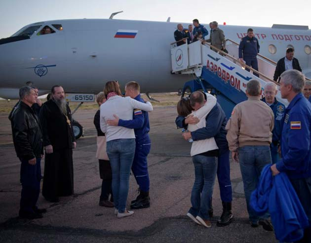 The astronauts, Hague (right) and Ovchinin (left), meeting their family, post-landing. (Source: NASA)