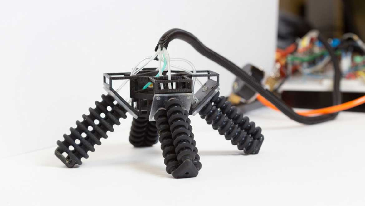 3D-Printed Four-Legged Robot Walks On Rough Surfaces