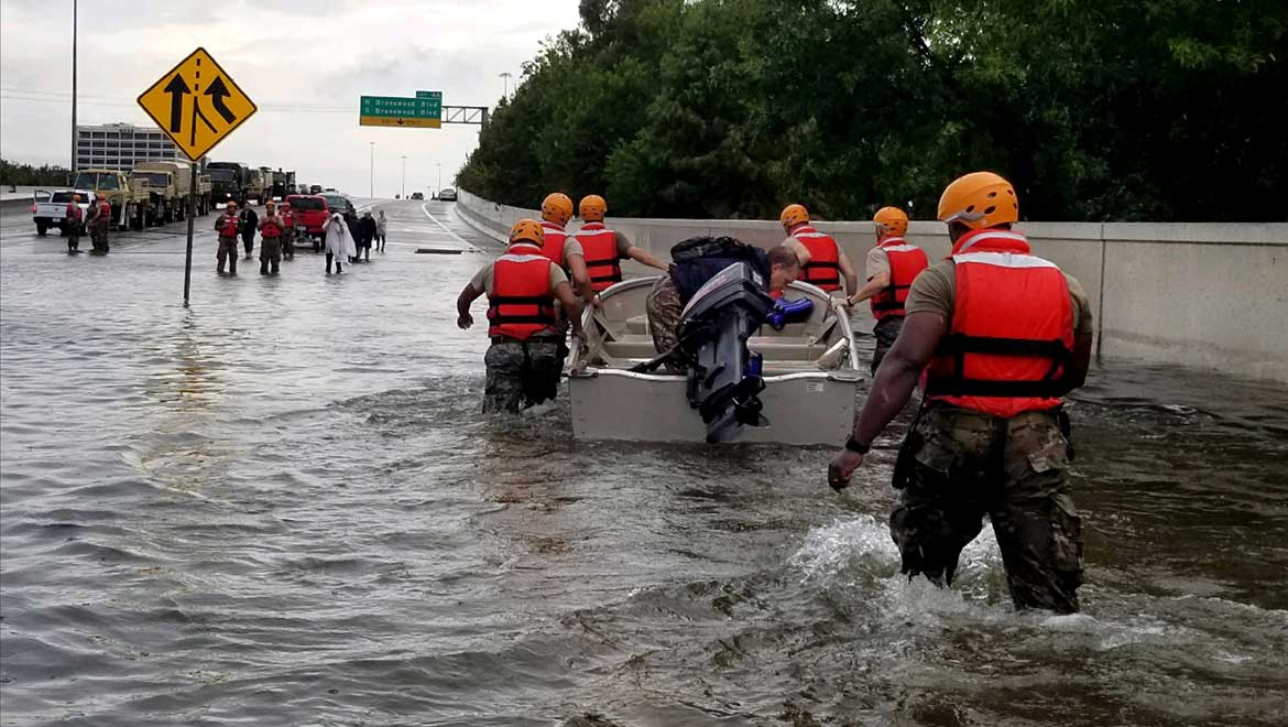Soldiers with the Texas Army National Guard move through flooded Houston streets as floodwaters from Hurricane Harvey continue to rise, Monday, August 28, 2017. More than 12,000 members of the Texas National Guard have been called out to support local authorities in response to the storm. (U.S. Army photo by 1st Lt. Zachary West)