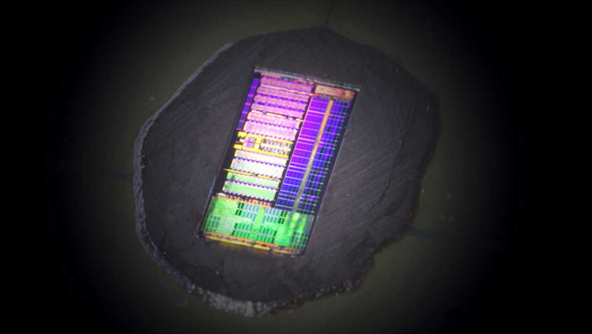 The illumination and camera create a rainbow-colored pattern across the electronic-photonic processor chip. (Image by Milos Popović, University of Colorado, milos.popovic@colorado.edu)
