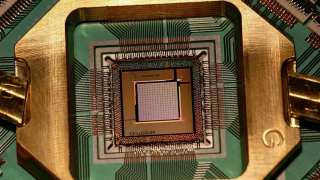 "Photograph of the D-Wave TwoX ""Washington"" quantum annealing processor chip mounted and wire-bonded in a sample holder. This chip was introduced in 2015 and includes 128,472 Josephson junctions."