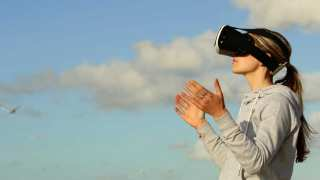 Side view of someone outside using virtual reality