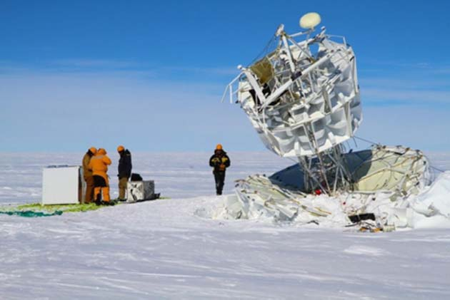 A team recovers NASA's Antarctic Impulsive Transient Antenna (ANITA) after a successful flight. (Source: Australian Antarctic Division)